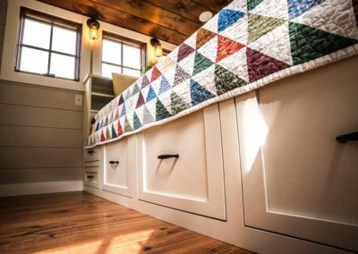 Built in storage under tiny house bed