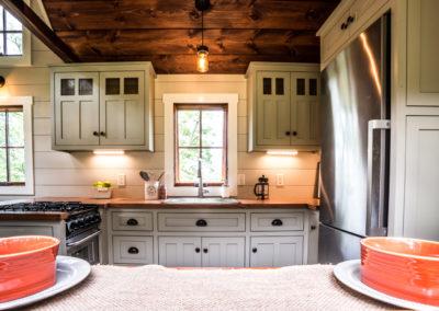 Custom kitchen in Denali tiny home by tinyhomebuildersflorida