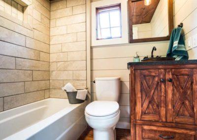 Tile shower in tiny home bathroom